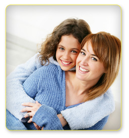 Adult Dental Health - Mother and Daughter Smiling