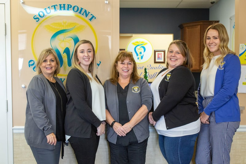 Fredericksburg Staff - Staff members standing in Southpoint Dental office in Fredericksburg
